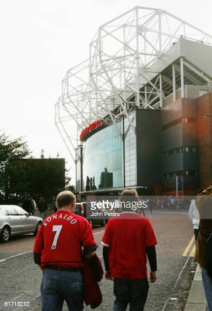 Fans walk towards Old Trafford's East Stand prior of the Barclays Premiership match between Manchester United and Arsenal at Old Trafford on October...