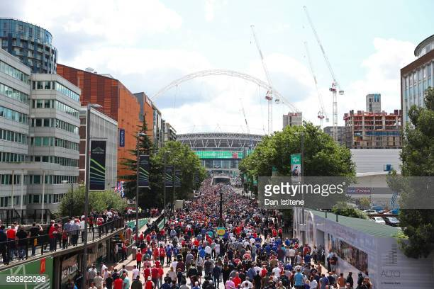 Fans walk up Wembley way towards the stadium prior to the The FA Community Shield final between Chelsea and Arsenal at Wembley Stadium on August 6...