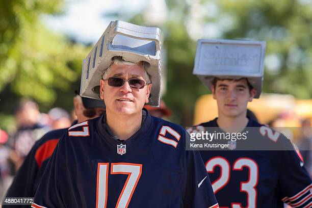 Fans walk wearing novelty hats outside of the stadium prior to the game between the Chicago Bears and the Green Bay Packers at Soldier Field on...