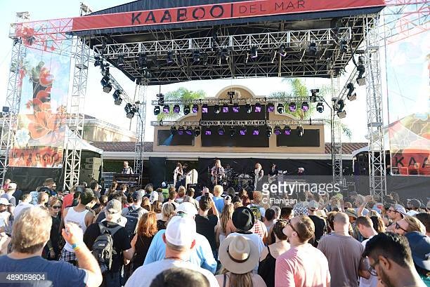Fans watch a band perform onstage during 2015 KAABOO Del Mar at the Del Mar Fairgrounds on September 18 2015 in Del Mar California