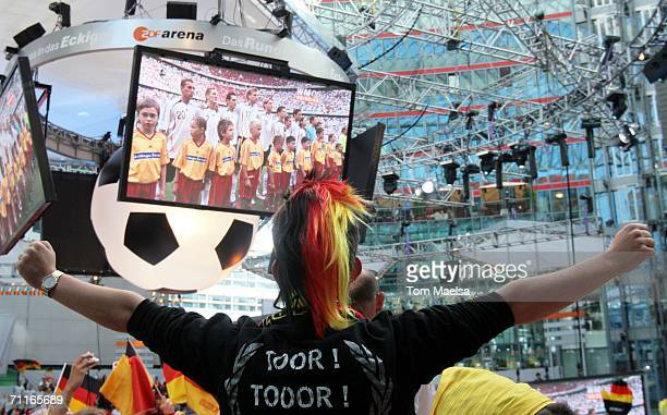 Fans watch a live broadcast of the Germany and Croatia opening game of the World Cup in front of the Reichstag on June 9 2006 in Berlin Germany...