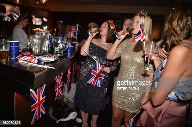 Fans watch a live screening of the wedding between Britain's Prince Harry and US actor Meghan Markle at a pub in Sydney on May 19 2018 Prince Harry...