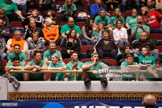 Fans watch a match during a bout in the 149 weight class during the Division III Men's Wrestling Championship held at the Cleveland Public Auditorium...