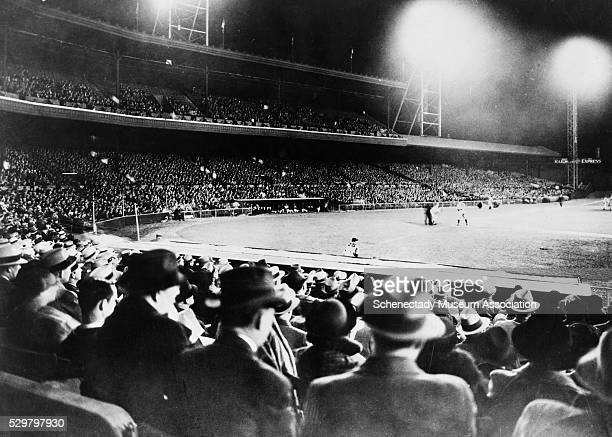 Fans watch a night game at Cincinnati's Crosley Field in 1935 with the aid of GE Novalux floodlights