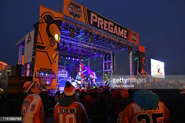 Fans watch a pregame concert before the 2019 Coors Light NHL Stadium Series between the Philadelphia Flyers and the Pittsburgh Penguins at Lincoln...