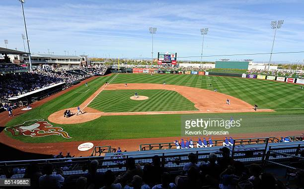 Fans watch a spring training game between Chicago Cubs and Texas Rangers at the Surprise Stadium on February 27 2009 in Surprise Arizona