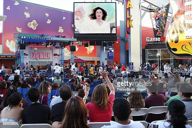 Fans watch a video of Michael Jackson during the Universal MoonWalk tribute to Michael Jackson at Universal CityWalk on July 9 2009 in Universal City...