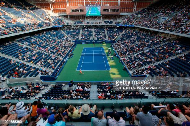 Fans watch a women's match in the new Louis Armstrong stadium during the 2018 US Open Tennis Tournament on August 27 2018 in New York