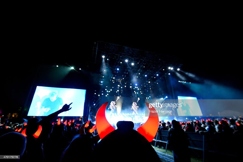 Fans watch AC/DC perform onstage during day 1 of the 2015 Coachella Valley Music And Arts Festival (Weekend 2) at The Empire Polo Club on April 17, 2015 in Indio, California.