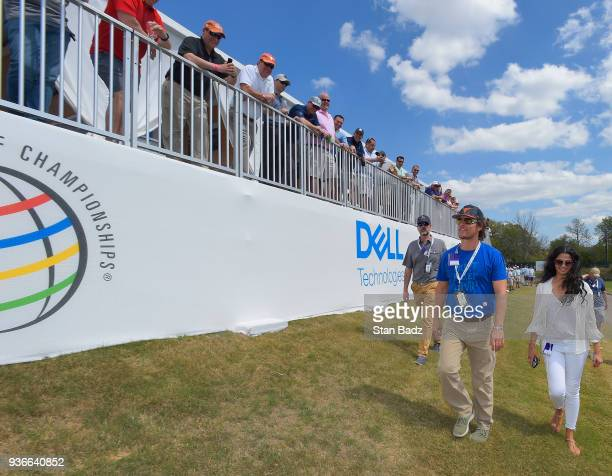 Fans watch actor Matthew McConaughey walking with his wife Camila Alves along the 15th hole during round two of the World Golf ChampionshipsDell...