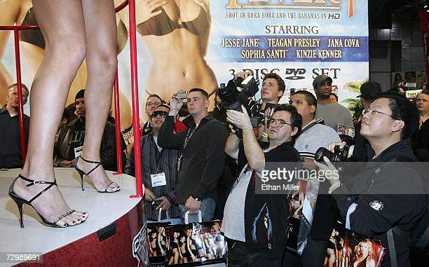Fans watch adult film star Mary Carey dance at the Adult Video News Adult Entertainment Expo at the Sands Expo Center January 12 2007 in Las Vegas...