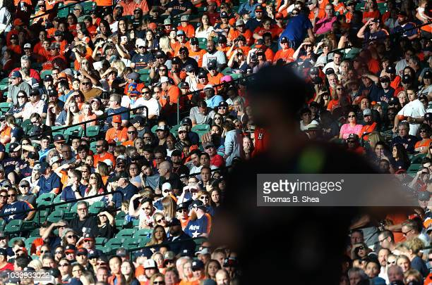 Fans watch AJ Pollock of the Arizona Diamondbacks bat against the Houston Astros in the first inning at Minute Maid Park on September 15 2018 in...