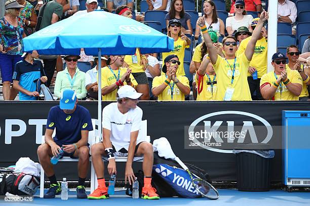 Fans watch Alex De Minaur and Max Purcell of Australia compete in their first round against Pablo Carreno Bustab of Spain and Guillermo GarciaLopez...