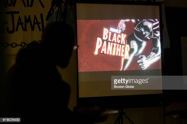 Fans watch an animated version of 'Black Panther' during a discussion of the significance of the upcoming release of the live action 'Black Panther'...