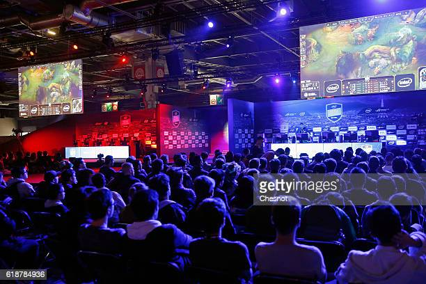 Fans watch an electronic video game tournament with the game 'League of Legends' developed by Riot Games during the 'Paris Games Week' on October 28...