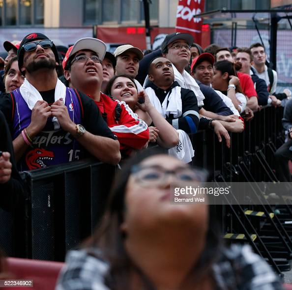 TORONTO, ON - APRIL 18 - Fans watch and cheer their team ...