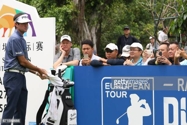 Fans watch and take picture with their smart phone of Bubba Watson of the United States during the third round of the Shenzhen International at...
