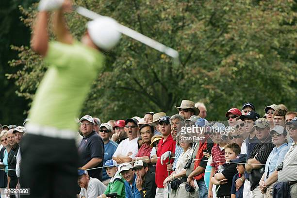 Fans watch Anthony Kim's tee shot at the 14th tee during the weatherdelayed second round of the BMW Championship held at Bellerive Country Club on...
