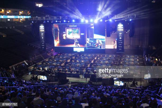 Fans watch as 80 players simultaneously fight for survival in an eSports match of upstart computer game PlayUnknown's Battlegrounds at an Intel...
