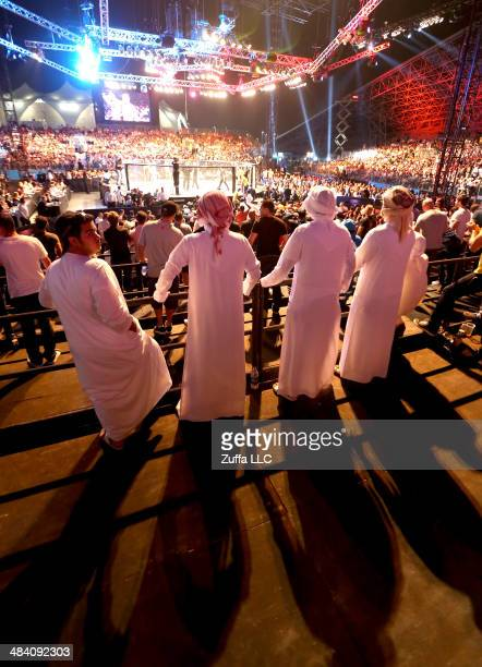 Fans watch as Alan Omer fights Jim Alers during their bout during UFC Fight Night 39 at du Arena on April 11, 2014 in Abu Dhabi, United Arab Emirates.