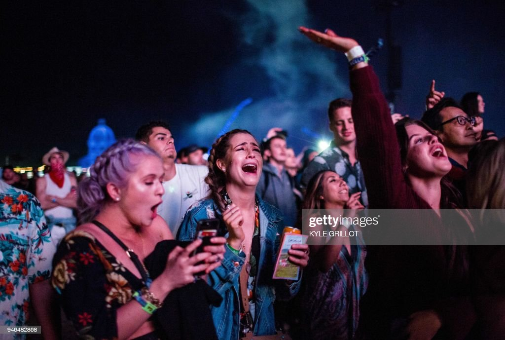 Fans watch as Beyonce enter the stage Saturday during the Coachella Music and Arts Festival in Indio, California, April 14, 2018. / AFP PHOTO / Kyle Grillot