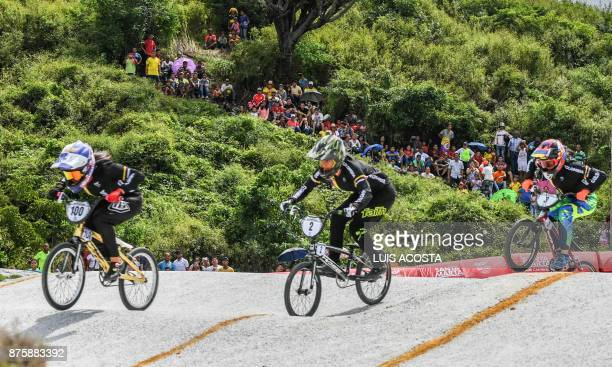 Fans watch as Colombia's Mariana Pajon Laura Ordonez and Maria Camila Restrepo compete in the women's BMX 20in final during the XVIII Bolivarian...