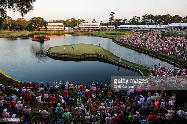 Fans watch as Kevin Kisner misses birdie putt on the 17th hole island green during a sudden death playoff against Rickie Fowler in the final round of...