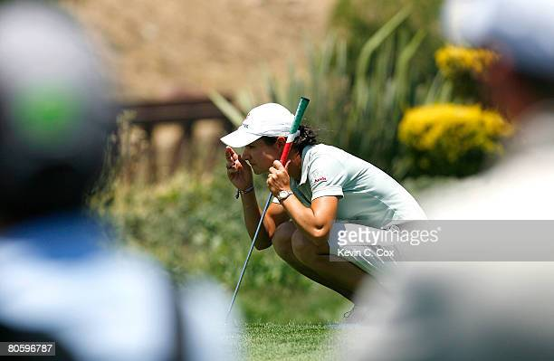 Fans watch as Lorena Ochoa of Mexico lines up her eagle putt on the fifth green during the first round of the Corona Championship April 10 2008 at...
