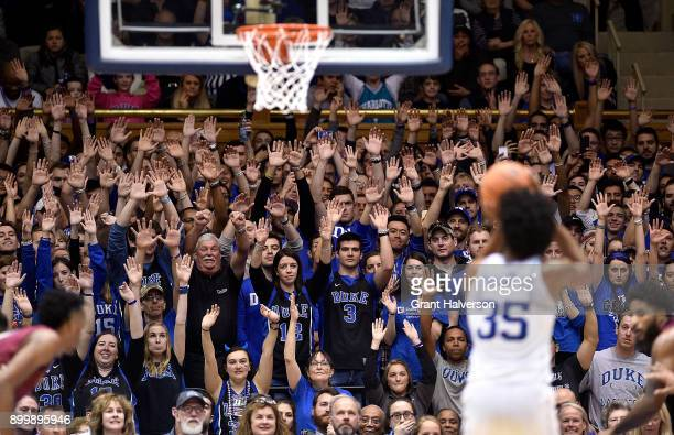 Fans watch as Marvin Bagley III of the Duke Blue Devils takes a foul shot against the Florida State Seminoles during their game at Cameron Indoor...