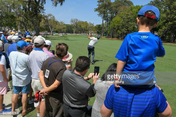 Fans watch as Matt Kuchar plays a shot on the sixth hole during the second round of the RBC Heritage at Harbour Town Golf Links on April 13 2018 in...