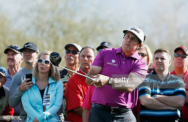 Fans watch as Phil Mickelson hits a shot during the proam prior to the start of the Waste Management Phoenix Open at TPC Scottsdale on January 28...
