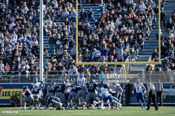 Fans watch as place kicker Spencer Pettit of the Nevada Wolf Pack kicks a field goal against the San Jose Stat Spartans at Mackay Stadium on November...