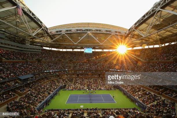 Fans watch as Rafael Nadal of Spain takes on Kevin Anderson of South Africa during their Men's Singles finals match on Day Fourteen during the 2017...