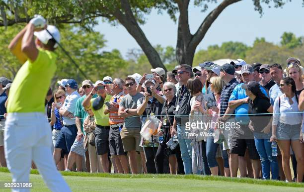 Fans watch as Rickie Fowler tees off on hole No 9 during the second round of the Arnold Palmer Invitational presented by MasterCard at Bay Hill Club...