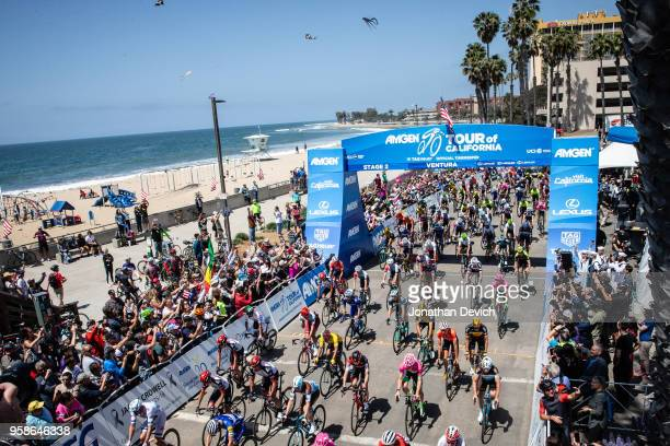 Fans watch as riders leave for the start of stage 2 of the Amgen Tour of California on May 14 2018 in Ventura California