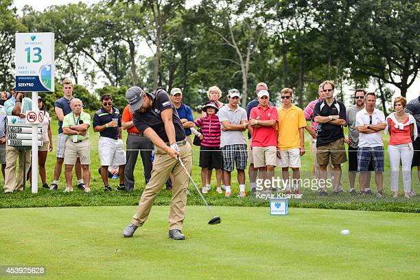 Fans watch as Ryan Moore tees off on the 13th hole during the first round of The Barclays at Ridgewood Country Club on August 21 2014 in Paramus New...