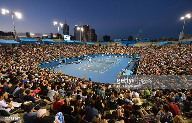 Fans watch as Spain's Fernando Verdasco competes during his men's singles match against Belgium's Xavier Malisse at Margaret Court arena on the third...