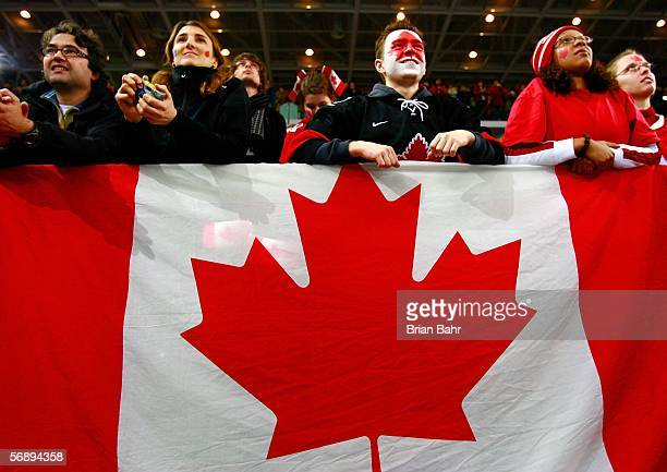Fans watch as Team Canada receives the gold medal following their 4-1 victory over Sweden during the final of the women's ice hockey on Day 10 of the...