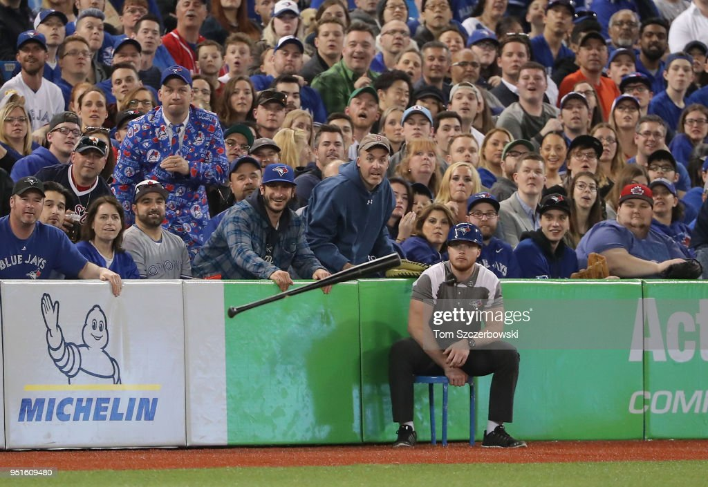 Fans watch as the bat of Hanley Ramirez #13 of the Boston Red Sox is hurled down the left-field line after he lost his grip on his bat while swinging in the third inning during MLB game action against the Toronto Blue Jays at Rogers Centre on April 26, 2018 in Toronto, Canada.