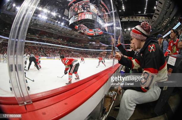 Fans watch as the Chicago Blackhawks take on the San Jose Sharks at the United Center on March 11, 2020 in Chicago, Illinois. The Blackhawks defeated...