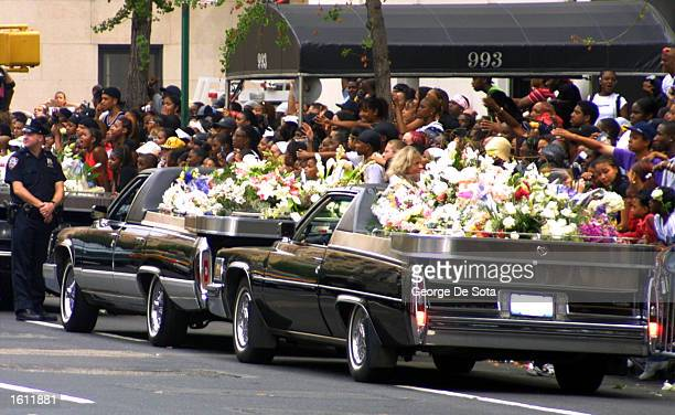 Fans watch as the funeral procession for the late RB singer Aaliyah passes by August 31 2001 in New York City The 22yearold singer died August 25 in...