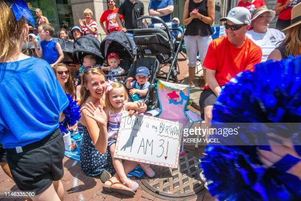 Fans watch as the Indy 500 Parade rolls through downtown Indianapolis May 25 2019 prior to the 103rd running of the Indianapolis 500 in Indianapolis...
