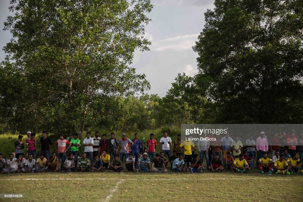 Fans watch as the Kedah Kulim Rohingya Football Club plays the Kedah Kulim junior team in a weekly match on April 13, 2018 in Kulim, Malaysia. A group of Rohingya refugees from Myanmar's Rakhine State formed the Rohingya Football Club in Malaysia back in 2015, hoping to give the Rohingya people a voice through sports and raise their international profile amidst the crisis in the region. Rohingya Muslims are reportedly playing in Football Clubs around the world, including Canada, Australia, and Ireland, while the Rohingya F.C. aims to set up a national team which comprises of these players and show that Rakhine Muslims can succeed in the sport. The United Nations estimate that over 62 thousand Rohingya are currently living in Malaysia and most of them are only able to find jobs as a construction worker or laborer with many staying in makeshift homes near construction sites. Malaysia launched its first Rohingya tournament this year with 24 independent football clubs competing across the Muslim country, hoping to gather support from the Malaysian and Turkish governments to help them succeed at an international level. Over 700,000 Muslim Rohingya have crossed the border into Bangladesh since August last year after the Myanmar military launched a brutal crackdown which was described by the United Nations as 'ethnic cleansing' while the two countries continue to negotiate the repatriation of the Rohingya refugees.