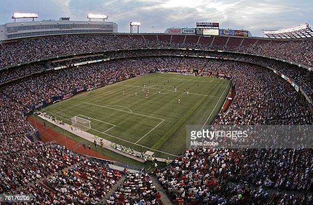 Fans watch as the Los Angeles Galaxy take on the New York Red Bulls at Giants Stadium on August 18 2007 in East Rutherford New Jersey