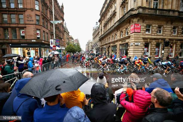 Fans watch as the peloton rides in the Men's Road Race during the road cycling on Day Eleven of the European Championships Glasgow 2018 at on August...