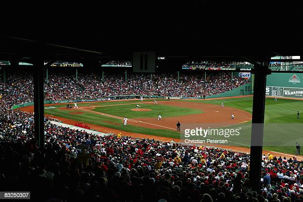 Fans watch as the Tampa Bay Rays play against the Boston Red Sox during game three of the American League Championship Series against during the 2008...