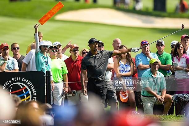 Fans watch as Tiger Woods reacts to his tee shot on the 11th hole during the second round of the World Golf ChampionshipsBridgestone Invitational at...