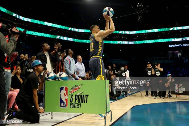 Fans watch at Stephen Curry of the Golden State Warriors shoots during the MTN DEW 3Point Contest as part of the 2019 NBA AllStar Weekend at Spectrum...