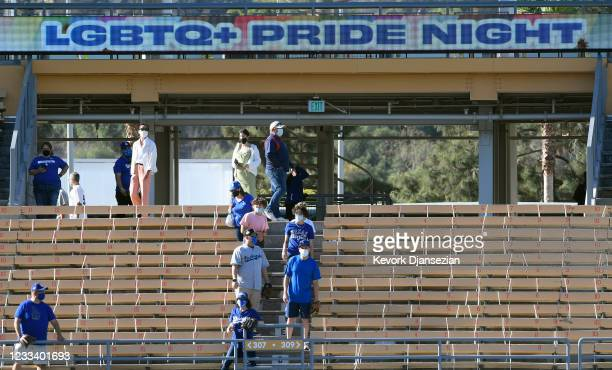Fans watch batting practice prior to the start of Los Angeles Dodgers and Texas Rangers during the eighth annual LGBTQ+ Night at Dodger Stadium on...