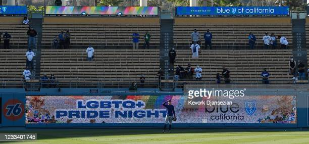 Fans watch batting practice prior to the start of Los Angeles Dodgers and Texas Rangers during eighth annual LGBTQ+ Night at Dodger Stadium on June...